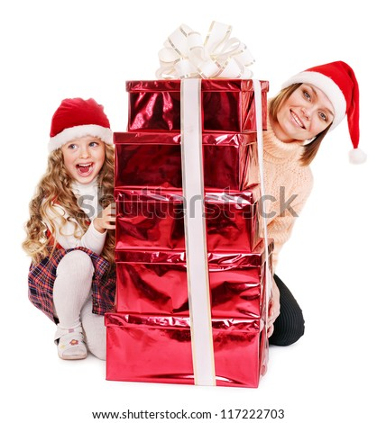 Happy family with child giving stack red  gift box. Isolated.