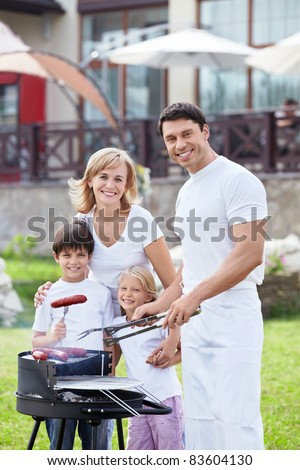 Happy family with children at barbecue