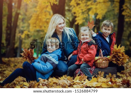 happy family with children in autumn Park #1526884799