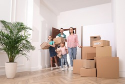 Happy family with children moving into new house