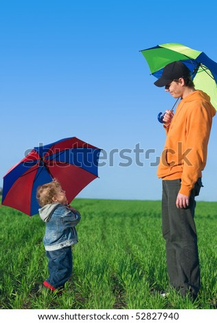 Happy family with children outdoors on a sunny day