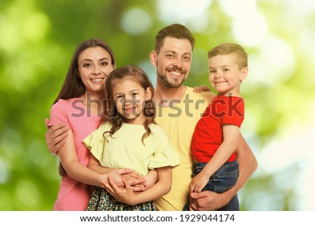 Happy family with children outdoors on sunny day Foto stock ©