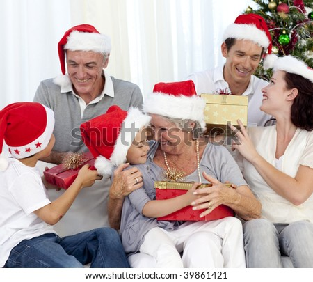 Happy family with Christmas gifts in sofa at home