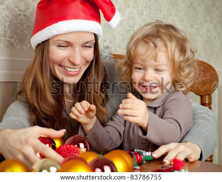 Happy family with Christmas tree decorations