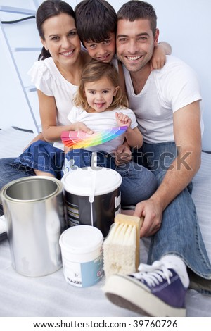 Happy family with color samples to paint new house