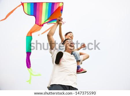 happy family with colorful kite - stock photo