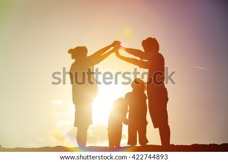 Shutterstock Happy family with kids and pregnant mother together at sunset