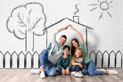 Happy family with kids dreaming about new house. Illustrations on brick wall
