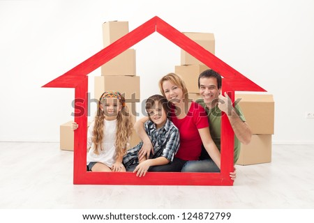 Happy family with kids moving into a new home concept - stock photo