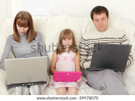 Happy family with laptop at room