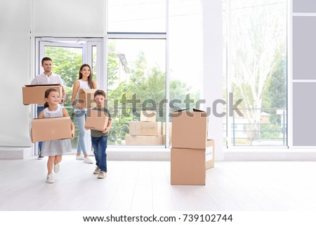 happy family with moving boxes...