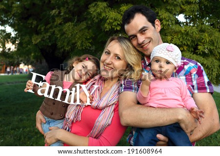 happy family with smiling faces outdoors
