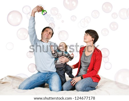 happy family with soap bubble on white background