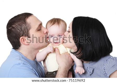 Happy family with the baby - stock photo