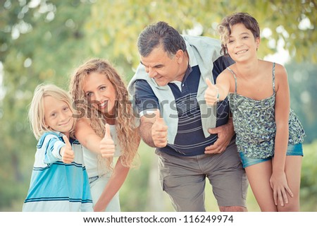 Happy Family with Thumbs Up,Italy
