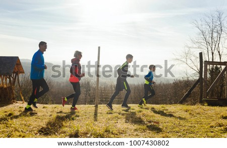 Happy Family with two boys running or jogging for sport - Shutterstock ID 1007430802