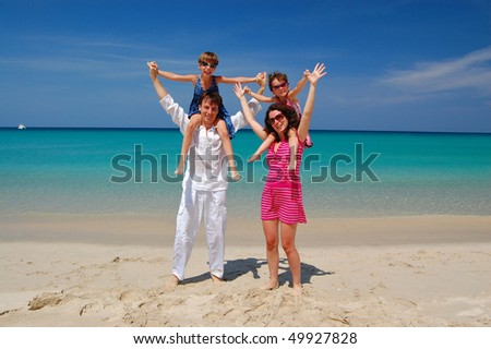Happy family with two children on beautiful tropical beach. Family vacation