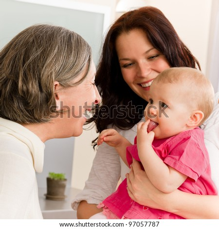 Happy family women - grandmother, mother and baby make funny face