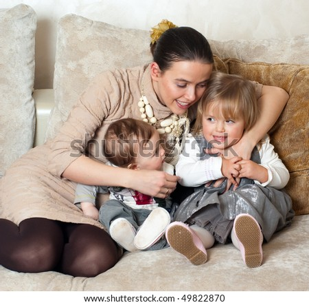 Happy family - Young beautiful mother with her little daughter and son