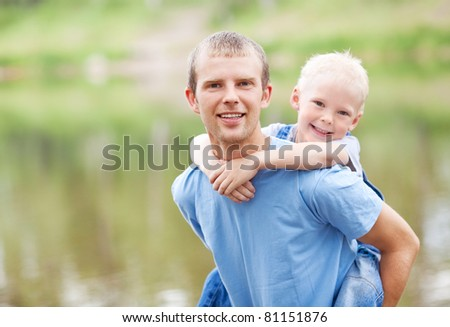 happy  family; young father and his five year old son near the lake outdoor on a summer day