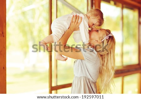 Happy family. Young mother and baby