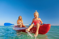 Happy family - young mother, children have fun on boat walk. Woman and child paddling on kayak. Travel lifestyle, parents with kids recreational activity, watersports on summer sea beach vacation.