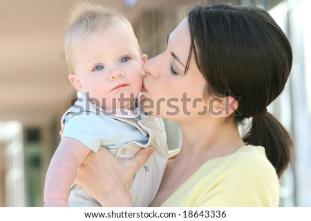 Happy family - young mother with her adorable baby boy son, suitable for a variety of family, parenting backgrounds