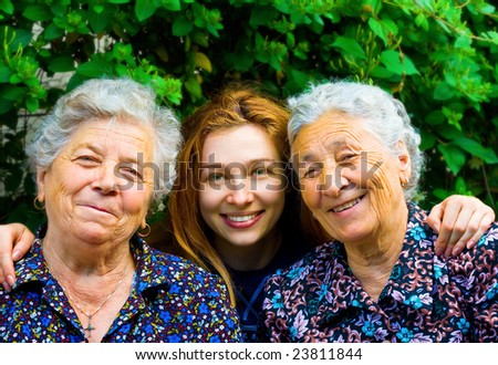 Happy family - young woman and two senior ladies