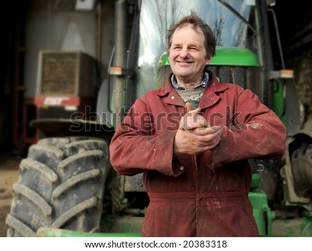 stock photo : Happy farmer rubbing hands together