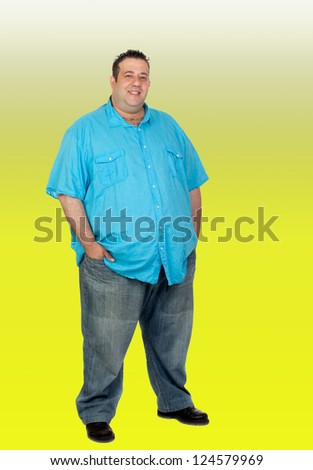 Happy fat man with blue shirt isolated with a green background