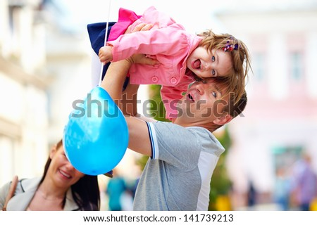 happy father and baby girl having fun, outdoors