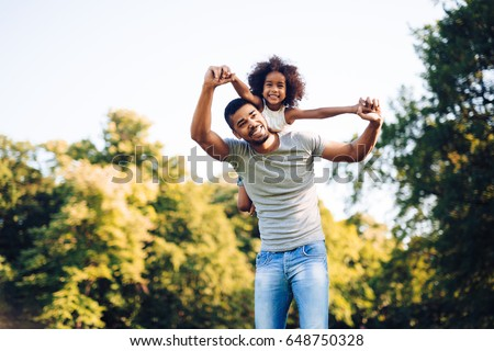 Happy father and child spending time outdoors
