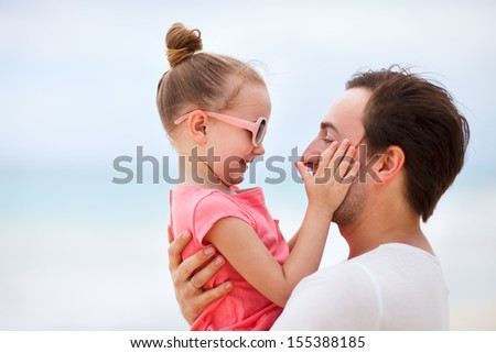 Happy father and his adorable little daughter outdoors