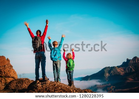 happy father and kids enjoy travel hiking in mountains #1280228395
