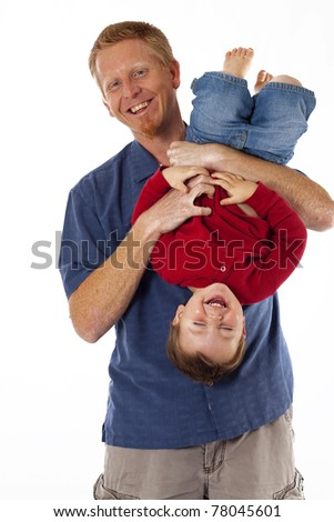 Happy father and small son playing and giggling - stock photo