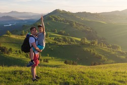 Happy father and son are walking in the Altai mountains