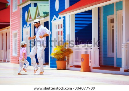 happy father and son enjoy life, dancing on caribbean street Foto stock ©
