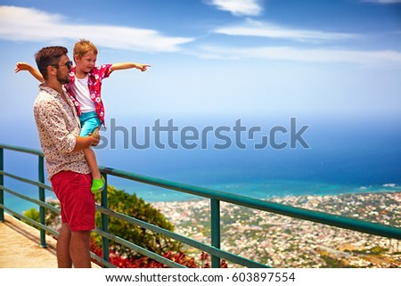 Shutterstock happy father and son enjoying the fascinating view on Atlantic ocean coastline from observation deck of Pico Isabel de Torres