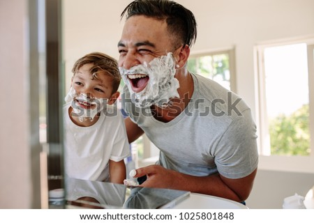 happy father and son having fun ...