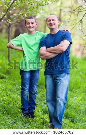 Happy father and son outdoor in the garden