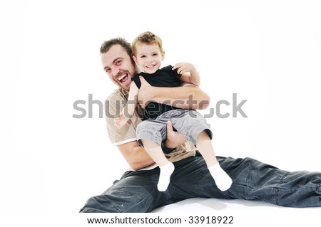 happy father and son play isolated on white in studio