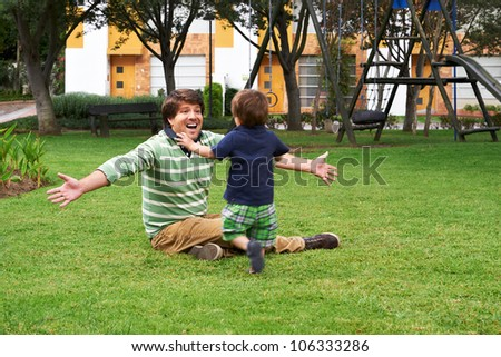 Happy Father and son playing at the park