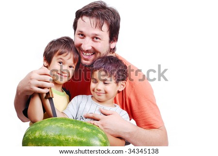 Happy father and two kids preparing watermelon