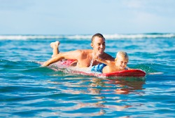Happy Father and Young Son Going Surfing Together. Fatherhood Concept, Quality Time with Child.