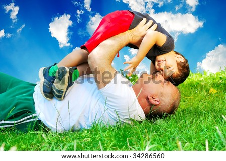 stock photo : Happy father or grandfather and son on beautiful background