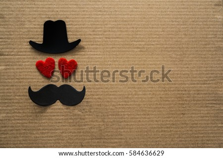 Happy Father's day background or card. black sign of hat, mustache and pipe with two red heart - eyes. empty copy space for inscription.  #584636629