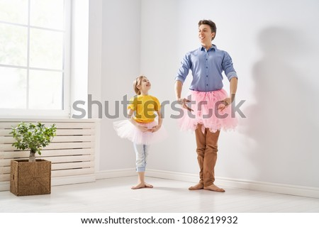 Happy father's day! Dad and his daughter child girl are playing, smiling and dancing. Family holiday and togetherness. #1086219932