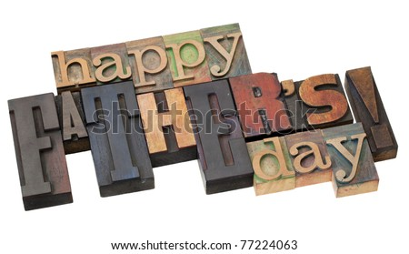 happy father's day in antique wood letterpress printing blocks isolated on white