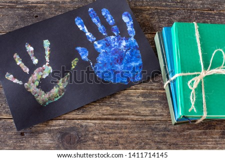 Happy Father's Day . Pictures, gifts, string lights and hand prints on the wooden rustic table