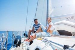 Happy father with adorable daughter resting on a big yacht